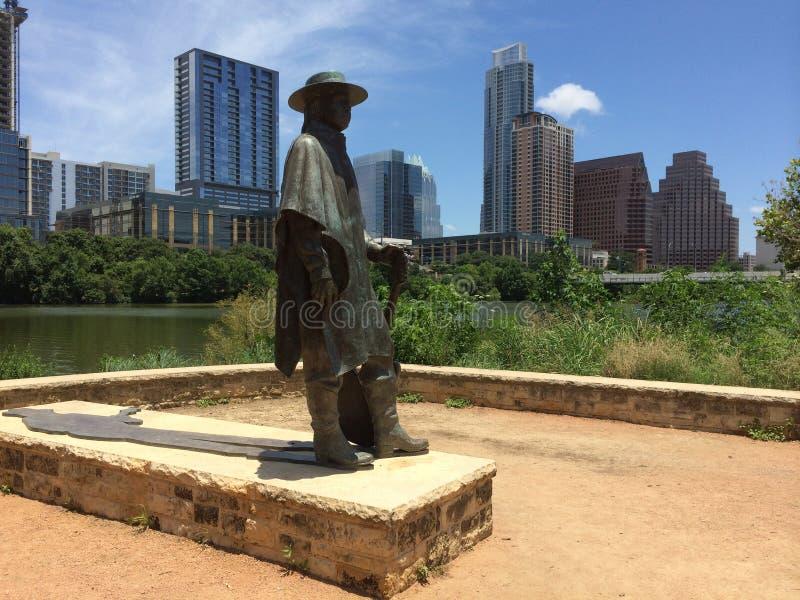 Stevie Ray Vaughan Statue avec Austin Texas à l'arrière-plan image stock