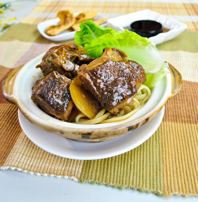 Stew fried duck noodle in claypot. food asian royalty free stock photography