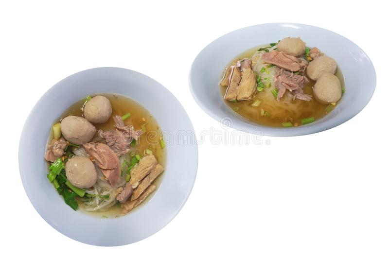 Stew meat clear soup noodles , the food with the seasoning beef ball and vegetable. isolated on white background with clipping stock image