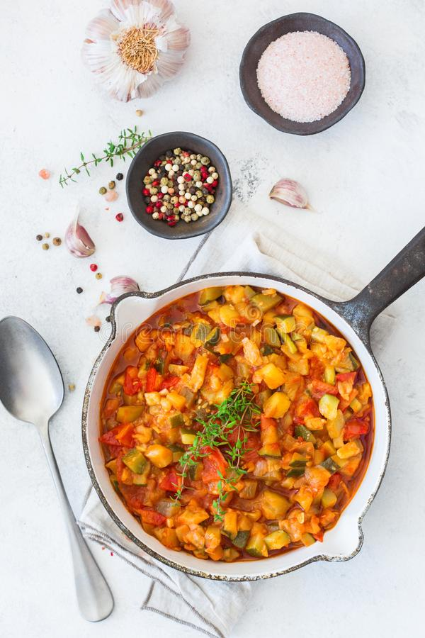 Stew organic vegetables ragout french ratatouille in frying pan. Healthy homemade vegan food concept. Stew organic vegetables ragout french ratatouille in frying stock photo