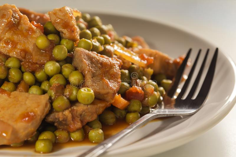 Stew with peas, pork meat and carrots royalty free stock photos
