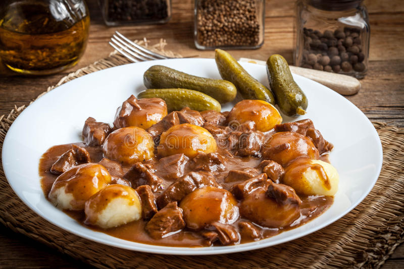 Stew served with silesian noodles and sauce. Selective focus stock photography
