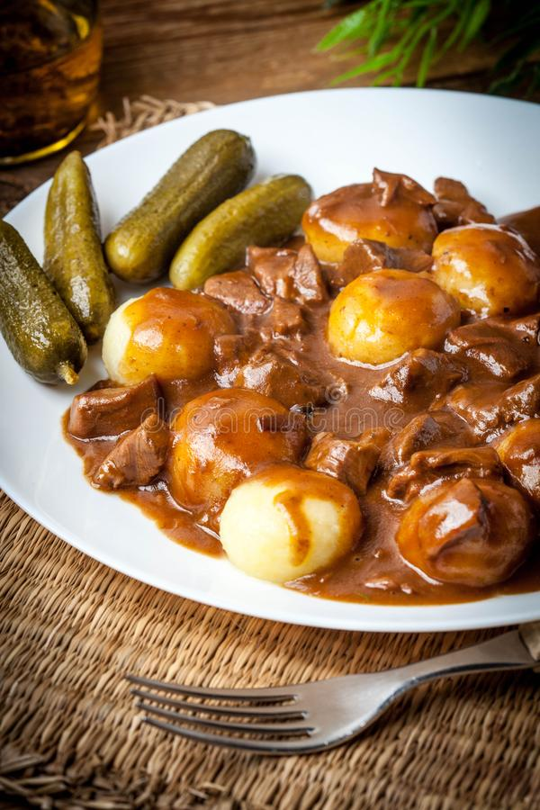 Stew served with silesian noodles and sauce. Selective focus stock image