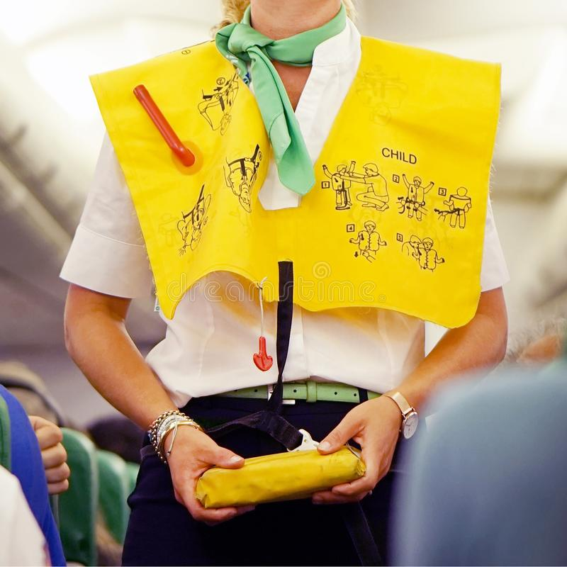Stewardess in the airplane stock image