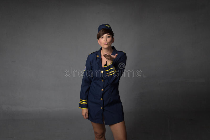 Stewardess blowing kisses. Textured background stock photos