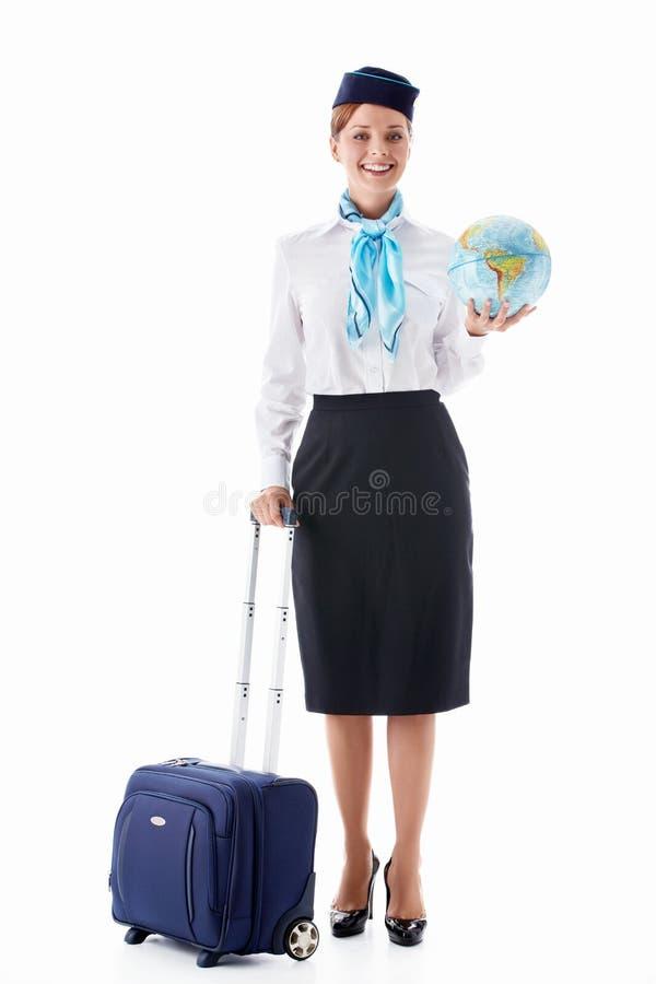 Stewardess con un globo fotografie stock