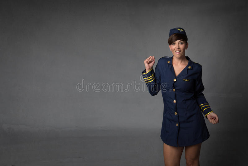 Stewardess in een wilde dans stock foto's