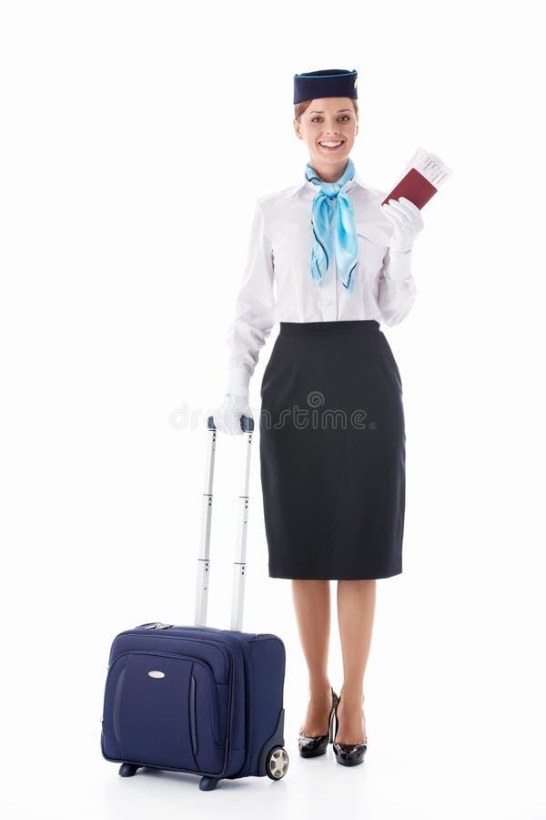 Stewardess met een paspoort royalty-vrije stock foto