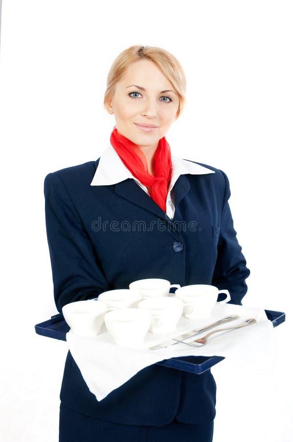 Stewardess met koppen royalty-vrije stock fotografie