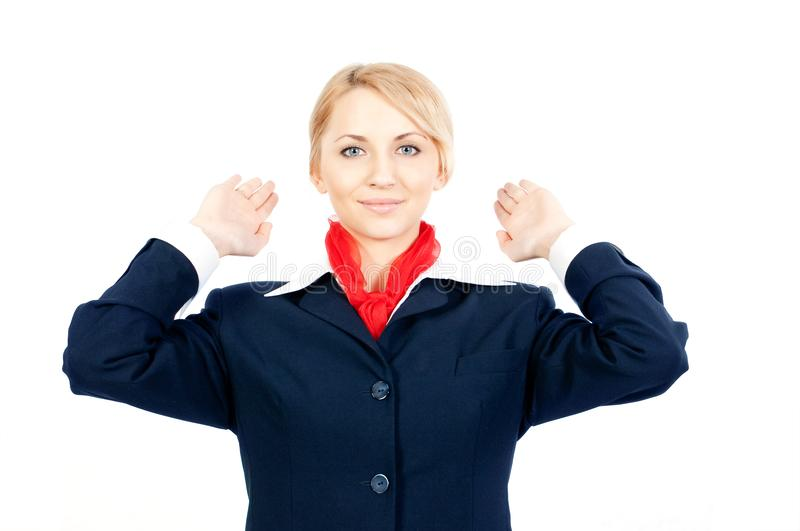 Stewardess showing the exit royalty free stock image