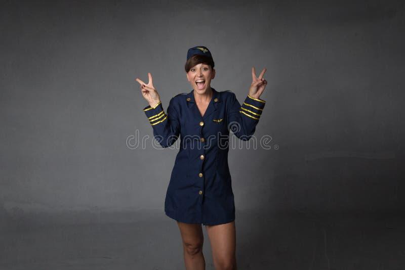 Stewardessgebaren v voor succes royalty-vrije stock afbeeldingen