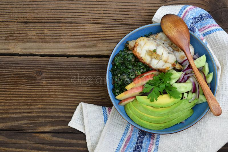 Stewed chard with apples, avocado, fish and salad of cucumbers, onions. AIP breakfast, dinner or lunch. Autoimmune Paleo. Diet hea. Lthy food concept. Cereals royalty free stock photography