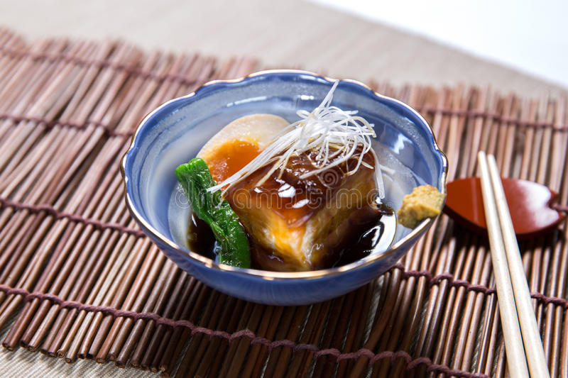 Stewed Pork Belly. (Buta Kakuni) with chopsticks stock photo