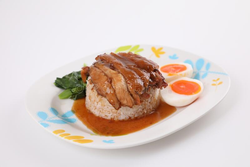 Stewed pork leg with rice local Thai food street food isolated in white background royalty free stock images