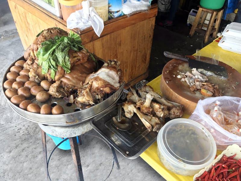 Stewed pork leg at rice shop, Egg and Pork in Sweet Brown Sauce, Cooked Stewed pork leg warmed, Egg and Pork in Sweet Brown Sauce stock images