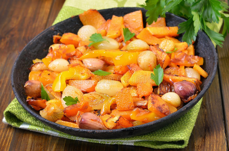 Stewed vegetables in frying pan. Close up view stock photography