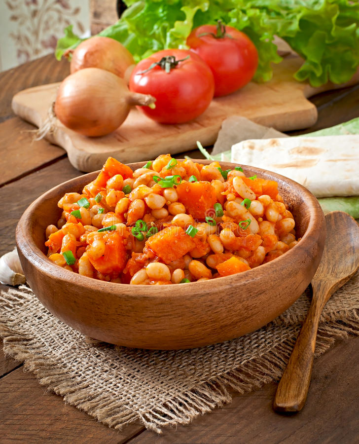 Stewed white beans and sliced pumpkin. In tomato sauce stock photography