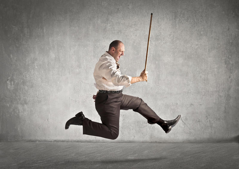 Stick. Fat man running with a stick stock photography