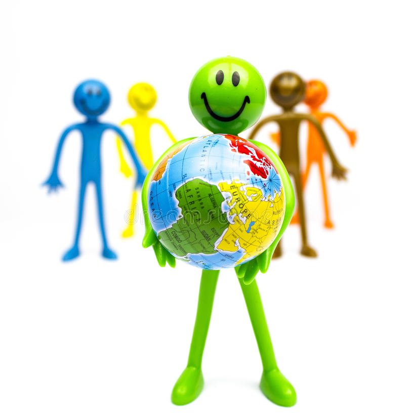 Stick busines man holding world. Group of clay, plastic stick men representing work , corporate or group. Holing a ball with the world in his hands.represents royalty free stock images