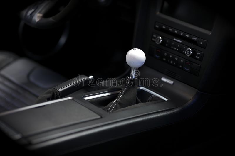 Stick Shift. Transmission. Sport Vehicle Interior. Elegant Sport Car Dark Interior with Central Console royalty free stock photography