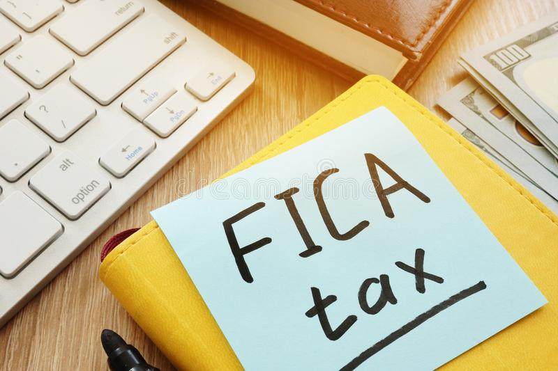 Stick with words fica tax and keyboard. Stick with words fica tax and the keyboard royalty free stock images