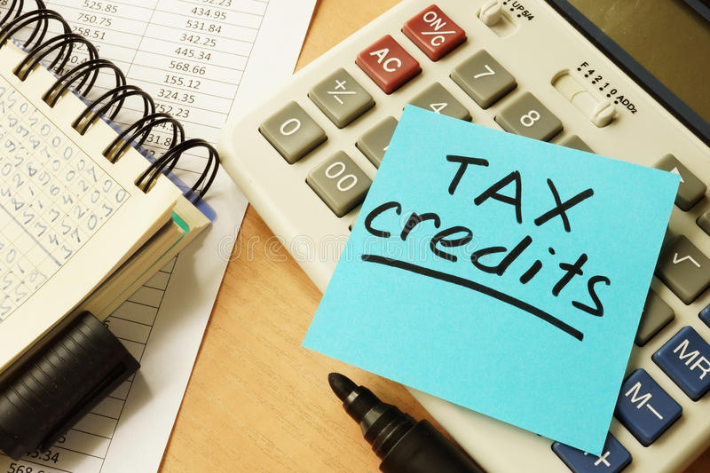 Stick with words tax credits. Memo stick with words tax credits royalty free stock images