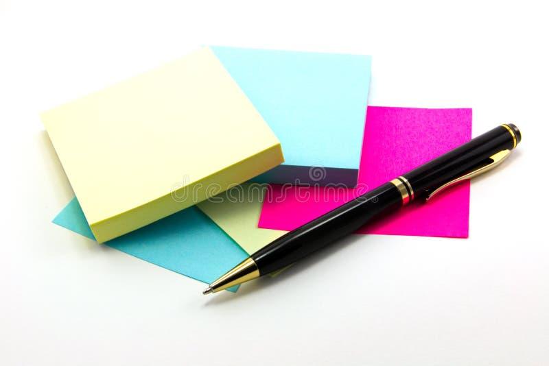 Sticker en pen stock afbeeldingen