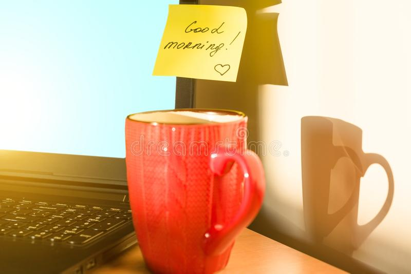 Sticker GOOD MORNING on laptop breakfast. Autumn-winter background stock images
