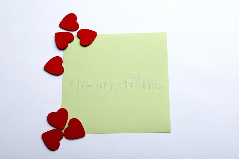Sticker and hearts on a white background. royalty free stock photography