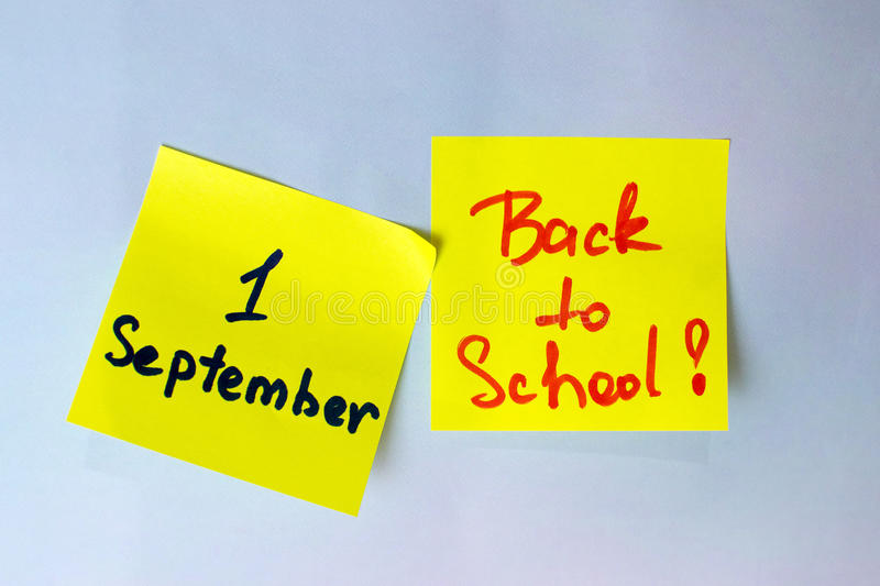 The sticker with the inscription go back to school and the first of September royalty free stock photography