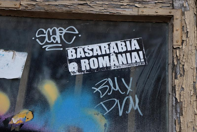 Sticker with the message `Bessarabia is Romania`. In Romanian `Basarabia e Romania`, glued on a window on a street in Bucharest. Messages that demand the stock images