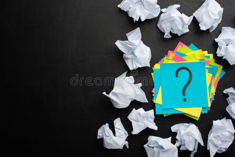 A sticker with a question mark and around crumpled paper, concept ideas, torment for ideas with empty space stock photo