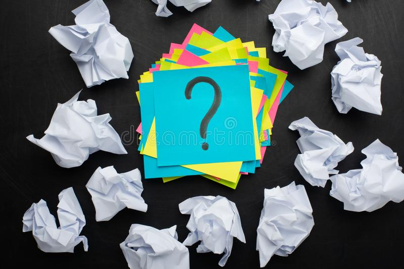 Sticker with a question mark and around crumpled paper, concept ideas, torment to ideas stock photography