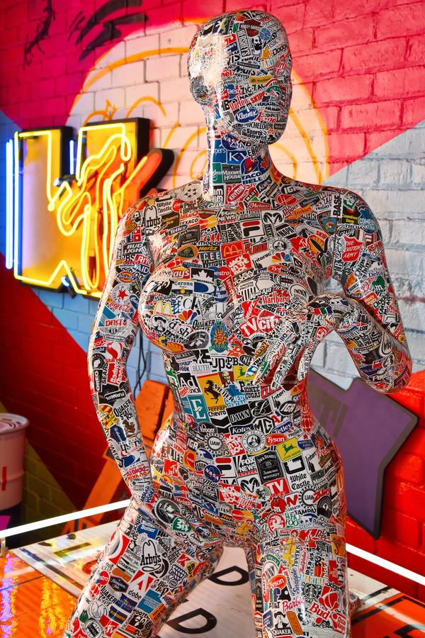 Stickered Mannequin Posing in Detroit. Sculpture of female covered in stickers creates a wonderful display at the headquarters of Denial in Eastern Market stock photos