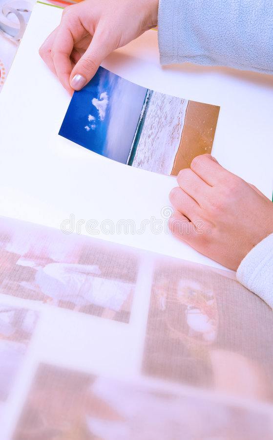 Sticking images to photo album royalty free stock images