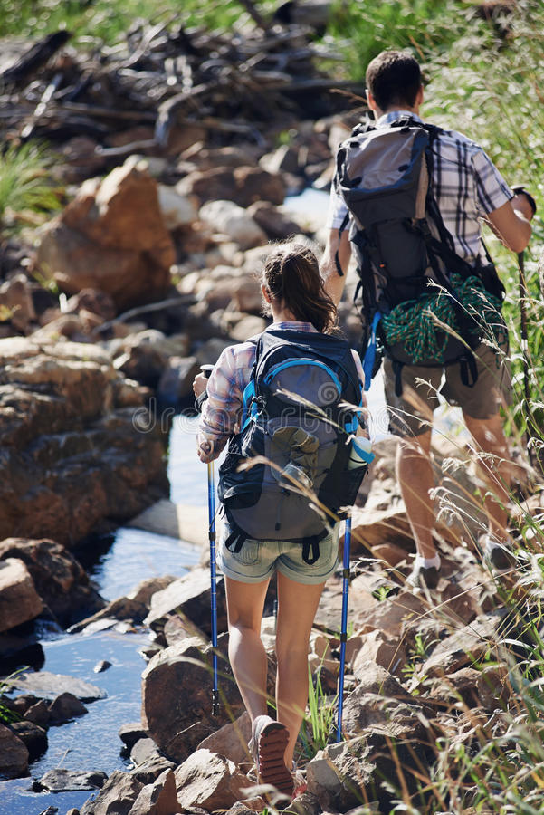 Sticking to the path by the water stock images