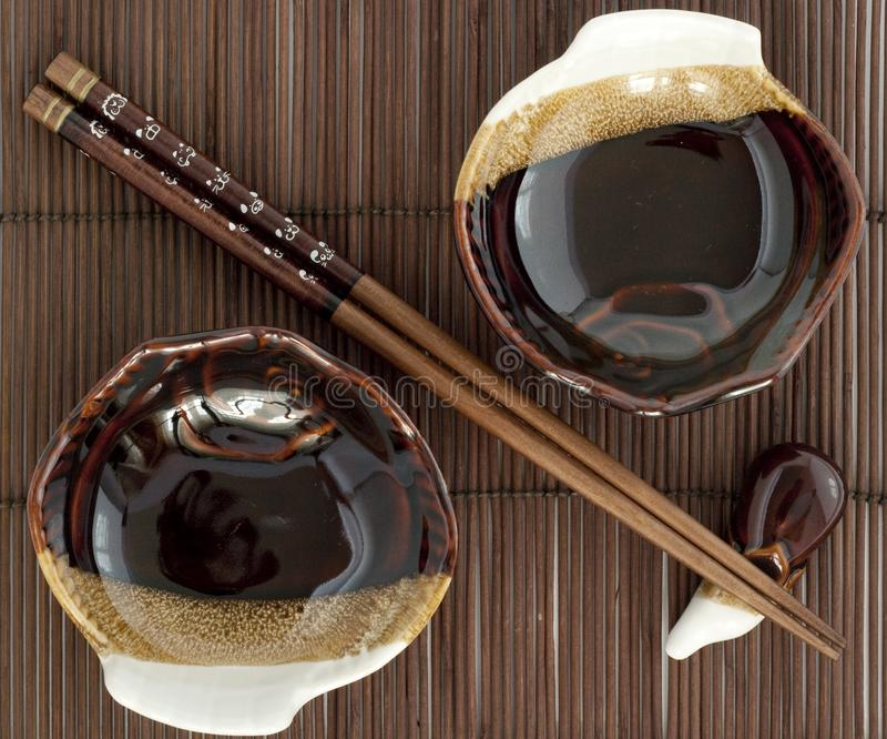 Download Sticks Fo Sushi And Two Plates On The Mat Stock Image - Image of sticks, ware: 14025079