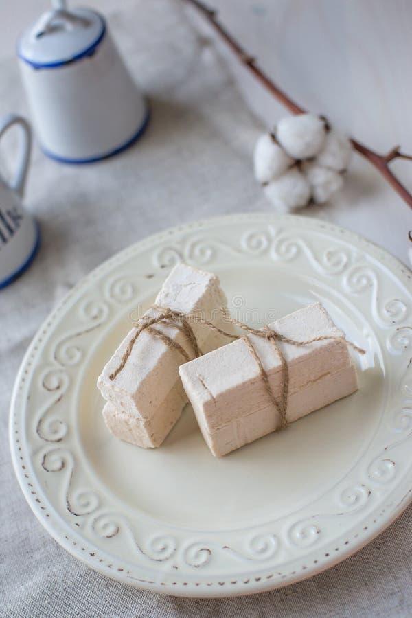 Sticks of marshmallow on a light background stock photos