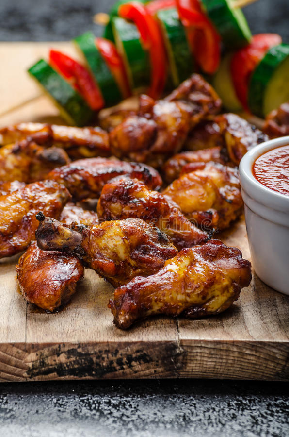 Sticky chicken with red hot dip stock photo