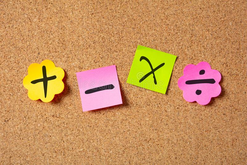 Sticky colorful notes in flower shape, isolated, with math symbols on corkboard stock image