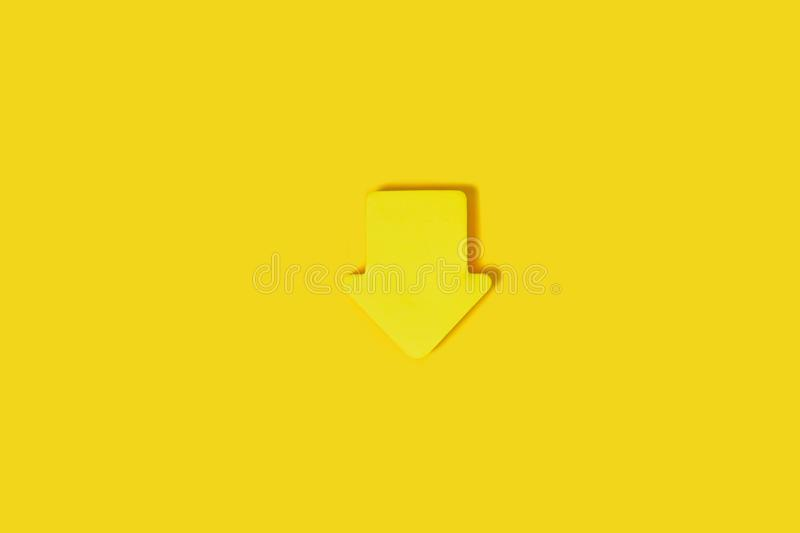 Sticky note block on a yellow surface. Sticky note block in a shape of a house lying isolated on yellow background. concept of office stationary. free space for stock image