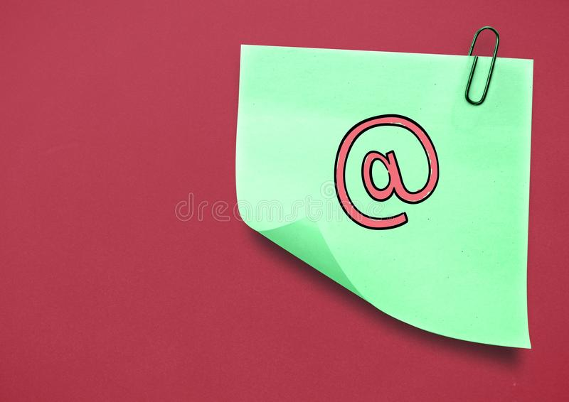 Sticky Note with Email icon against red background royalty free stock image