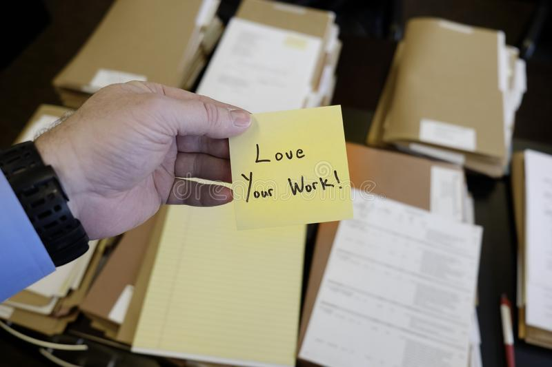 Sticky Note in Hand Businessman Desk Files Folder Working Love Your Work. Sticky Note in Hand Businessman Desk Files Folder Working Message Motivation Love Your stock photography