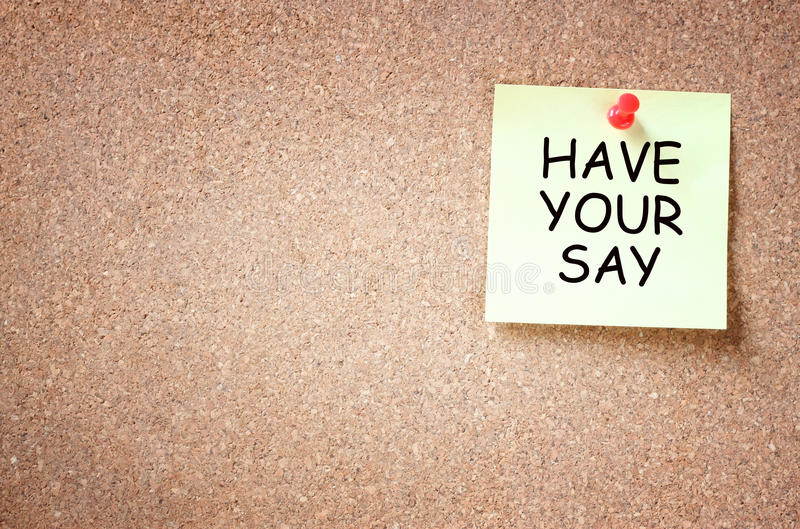 Sticky note with the phrase have your say. room for text. stock photos