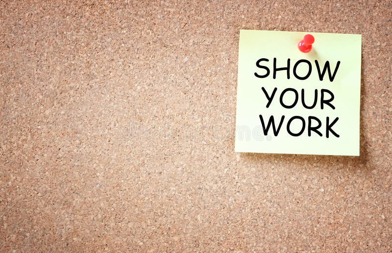 Sticky note pined to cork board with the phrase show your work written on i. T. room for text royalty free stock images