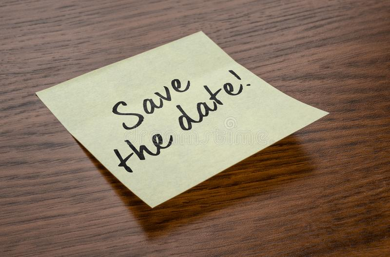 Sticky note with the text Save the date royalty free stock images