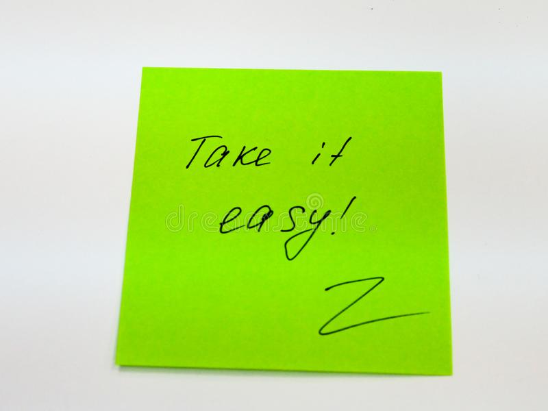 Sticky note with text take it easy royalty free stock photography