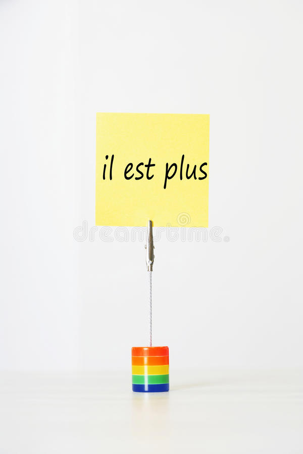 Download Sticky Notepaper With French Text Il Est Plus (It's Over) Clipped To A Multicolored Card Holder Stock Photo - Image: 30856732