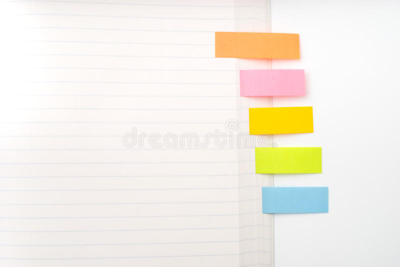 Sticky notes. Five colors sticky notes attaching a note royalty free stock image