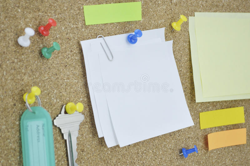 Sticky notes, pin, key and tag name on cork board. Colorful sticky notes, pin, key and tag name on cork board stock photo